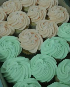 Pastel cupcakes in mint and peach with silver sprinkles