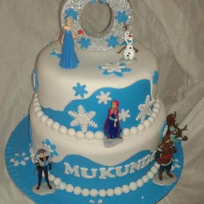 2-tier Frozen birthday cake with figurines