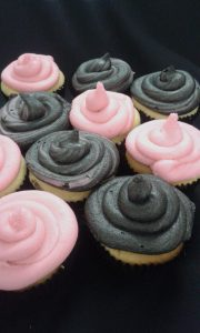 Pink and black frosted cupcakes