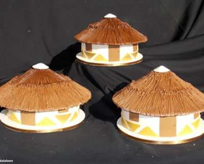 Traditional African huts wedding cake