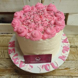 Pink icing flower cake