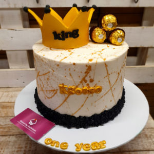 gold and white crown birthday cake