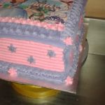 Square pink and purple Sofia the First birthday cake with printed topper