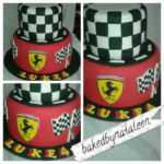2-tier Formula 1 Grand Prix birthday cake in red, yellow, black & white