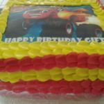 "Square ""Cars"" theme cake with printed topper"