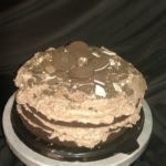 Oreo chocolate cake with chocolate cream and crushed Oreo topping